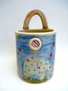 Ceramic elephants spoonholder by Yvonne Halton