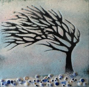 Windswept tree in winter by Jeanette Hannaby